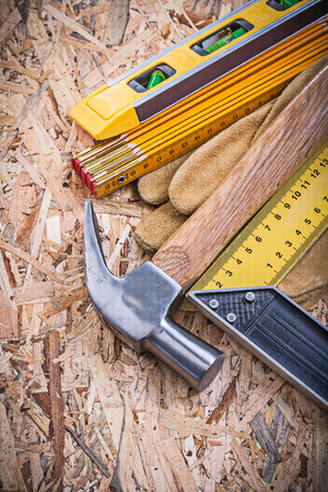 protective gloves: Claw hammer protective gloves construction level wooden meter square ruler. Stock Photo