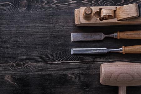 chisels: Flat chisels lump hammer shaving plane construction concept.