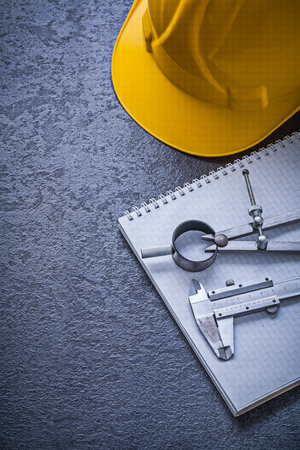 copybook: Copybook hard hat drawing compass vernier scale construction concept.
