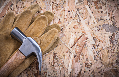 claw hammer: Claw hammer pair of leather safety gloves on OSB.