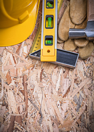 square ruler: Square ruler construction level claw hammer building helmet safety gloves.