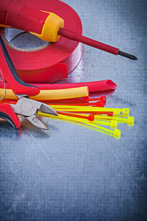 dielectric: Insulating tape electric wires plastic cable ties screwdriver cutting pliers.