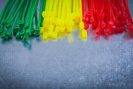 cable tie: Heap of plastic cable ties on metallic background.