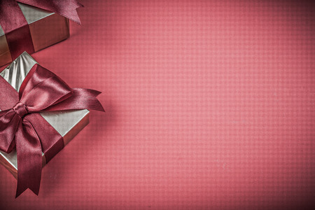 red glittery: Composition of present boxes on red background holidays concept. Stock Photo