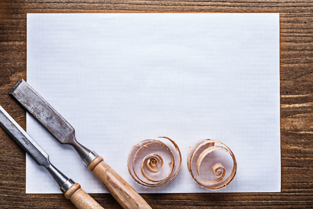 scobs: Blank sheet of paper wood scobs flat chisels construction concept. Stock Photo