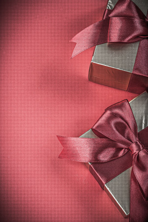 red glittery: Giftboxes on red background vertical version holidays concept.