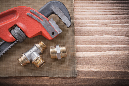 household fixture: Monkey wrench pipe fittings water mesh filter grid construction concept. Stock Photo
