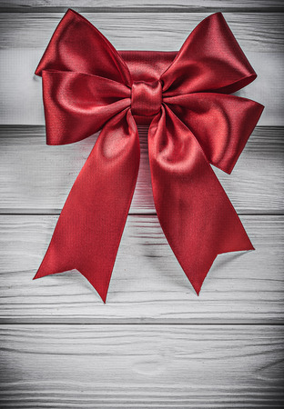paper roll: Paper roll with red bow on wooden board holidays concept.