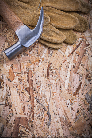 claw hammer: Claw hammer pair of safety gloves on OSB.