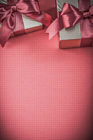 beautiful anniversary: Gift boxes on red background close up view holidays concept. Stock Photo