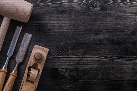 chisels: Firmer chisels wooden mallet shaving plane copyspace construction concept. Stock Photo