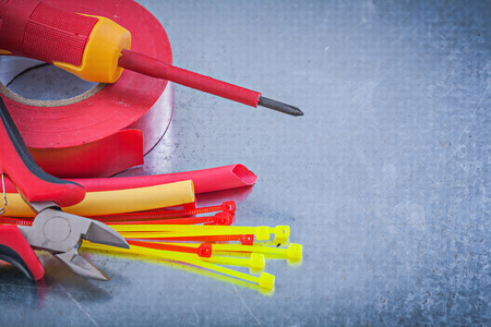 dielectric: Insulating tape electric wires plastic cable ties screwdriver nippers. Stock Photo