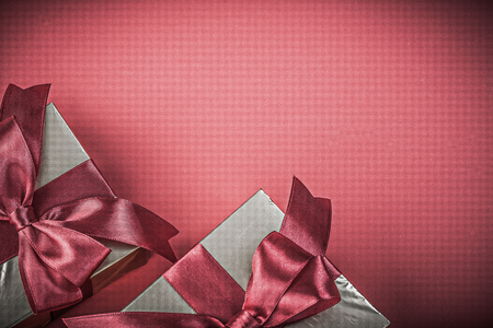 red background: Present boxes on red background top view holidays concept. Stock Photo