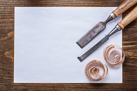 scobs: Blank sheet of paper wood scobs firmer chisels construction concept.