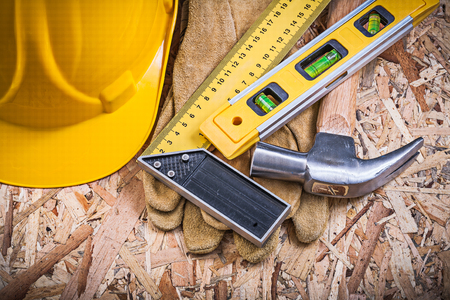 claw hammer: Square ruler construction level claw hammer hard hat working gloves.