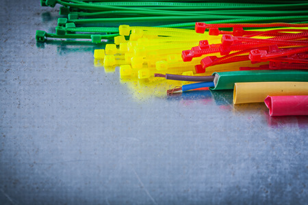 cable tie: Collection of plastic cable ties electric wires on metallic background. Stock Photo