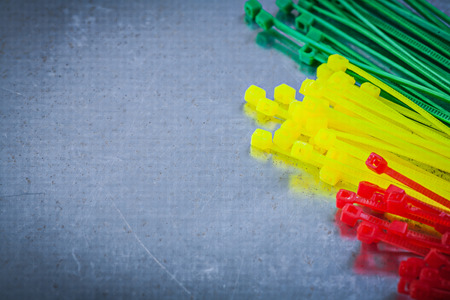 cable tie: Set of plastic cable ties on scratched metallic background. Stock Photo