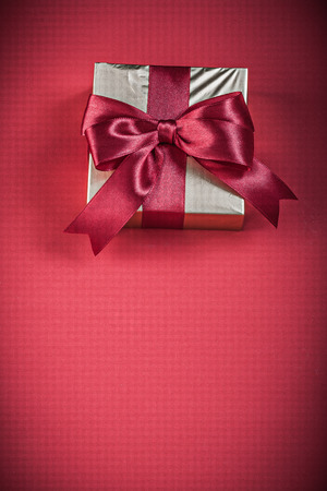golden background: Giftbox on red background holidays concept. Stock Photo