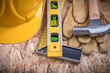 square ruler: Square ruler construction level claw hammer building helmet leather gloves.