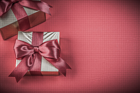 red glittery: Gift boxes on red background horizontal image holidays concept. Stock Photo