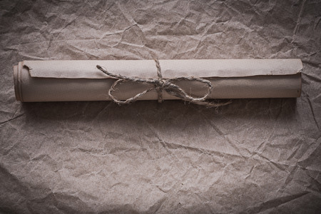 pack string: Vintage paper scroll on crumpled wrapping sheet.