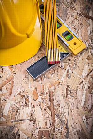 construction level: Square ruler construction level wooden meter hard hat on OSB.
