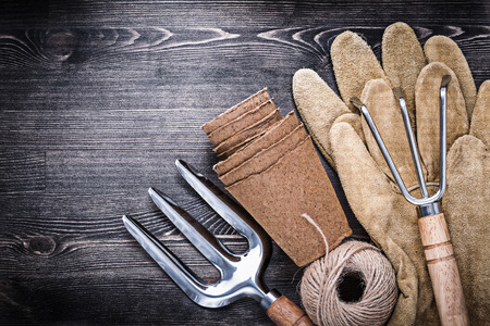 peat pot: Trowel fork rake leather gloves hank of rope peat pots. Stock Photo