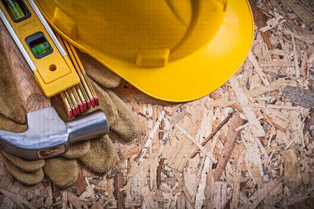 leather gloves: Hammer safety leather gloves construction level wooden meter hard hat.