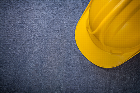 hard hat: Hard hat on black background copy space construction concept. Stock Photo