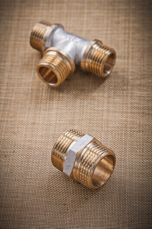 household fixture: Plumbing fixtures pipe fittings on water mesh filter. Stock Photo
