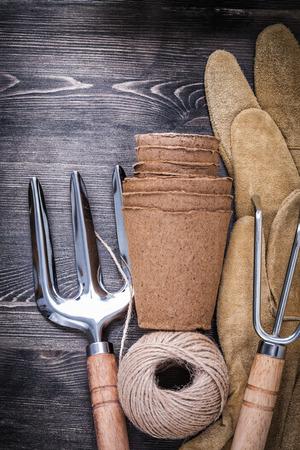 hank: Trowel fork rake protective gloves hank of rope peat pots.