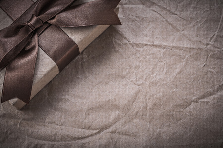 packed: Packed present box on wrapping paper holidays concept.