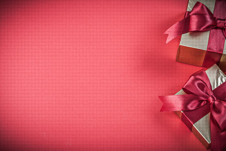 red glittery: Gift boxes on red background copyspace holidays concept.