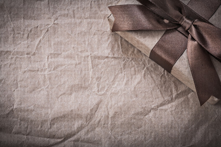 wrapped present: Wrapped present box on wrapping paper holidays concept. Stock Photo