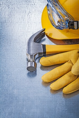 protective eyewear: Protective eyewear building helmet safety gloves claw hammer construction concept. Stock Photo