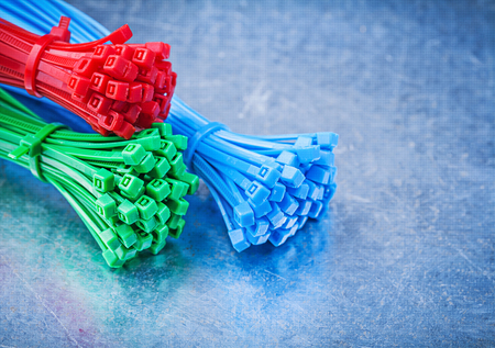 cable tie: Horizontal view of cable ties on metallic background construction concept. Stock Photo