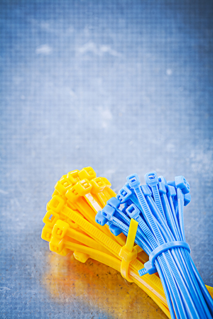 cable tie: Set of self-locking cable ties on metallic background construction concept.