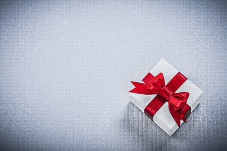 packed: Packed present box on white background holidays concept.