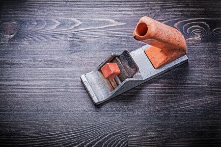 handy: Handy mini woodworking vintage plane on wooden board.