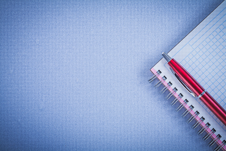 copybook: Red pen blank copybook copy space office concept. Stock Photo