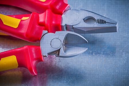 wire cutter: Pliers wire cutter on metallic background horizontal image electricity concept.