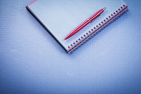 red pen: Red pen blank checked copybook office concept.