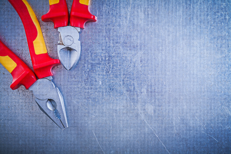 dielectric: Set of pliers wire-cutter on metallic background electricity concept.