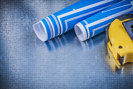 Blue construction plans tape line on metallic background maintenance concept. Stock Photo