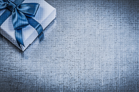 giftbox: Giftbox blue bow on metallic background greeting card celebrations concept.