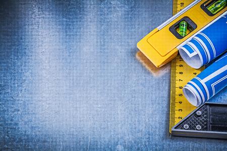 square ruler: Blue blueprints construction level square ruler on metallic background.