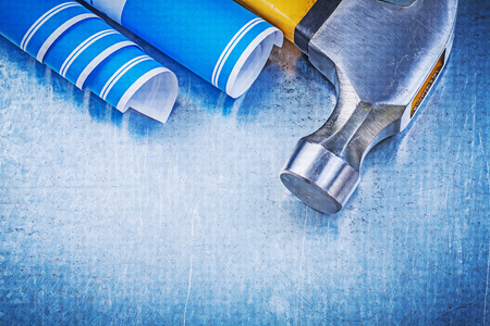 claw hammer: Blue blueprints claw hammer on metallic background.