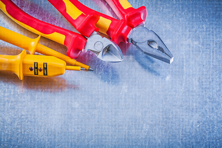 nippers: Electric tester pliers nippers on metallic background electricity concept. Stock Photo