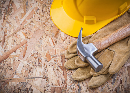 leather gloves: Set of claw hammer hard hat leather gloves construction concept. Stock Photo
