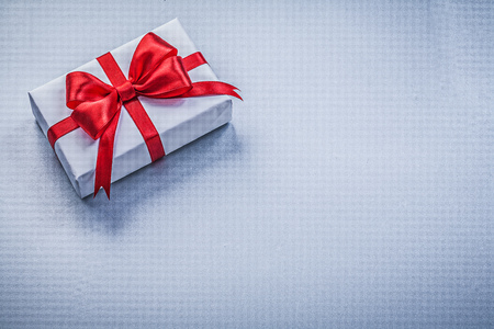 wrapped present: Wrapped present red ribbon on blue background holidays concept.